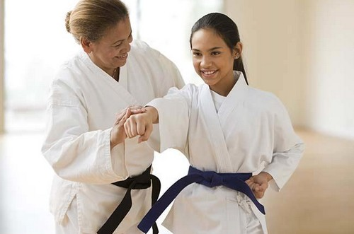 woman_teaching_girl_martial_arts.jpg-Retired from Teaching
